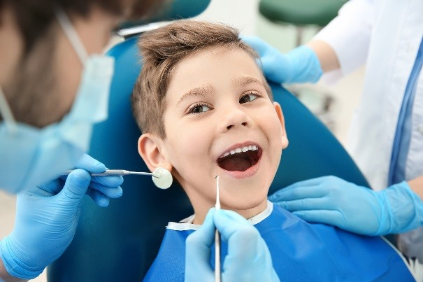 Pediatric patient at Dental Health Associates getting teeth cleaned