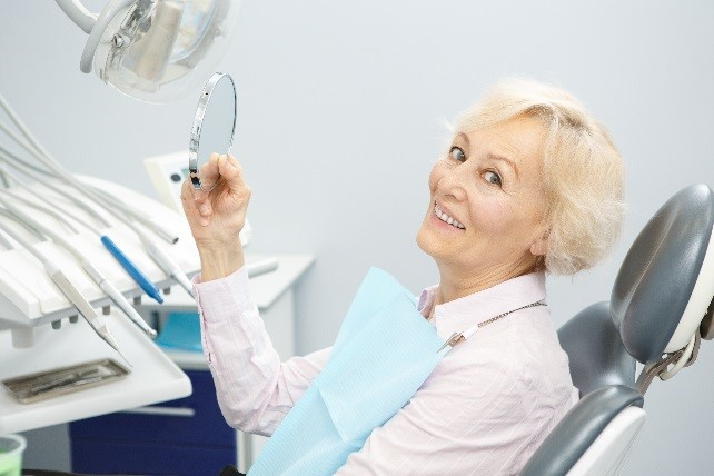 Swanton, OH patient fitted for dentures at Dental Health Associates