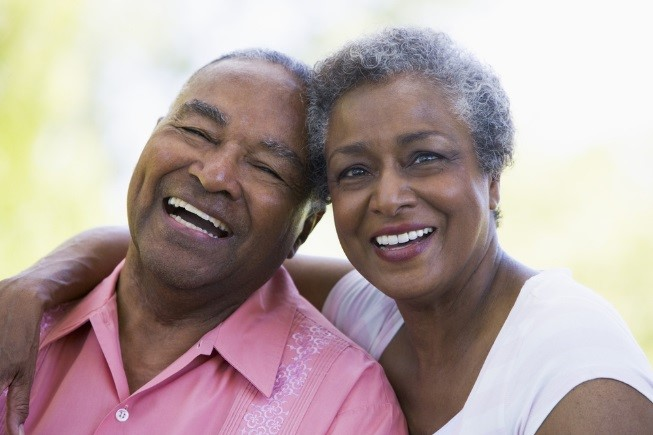 Swanton patients after being fitted with full dentures at Dental Health Associates