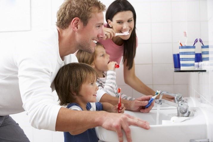 Dental Health Associates patients in Swanton, OH brushing teeth